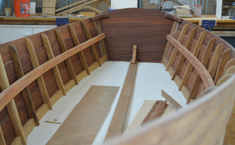 The skiffs combine traditional riveted lapstrake planking on the sides with a plywood rather than a cross-planked bottom.