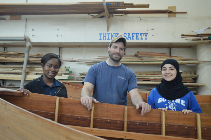 Alor Henderson, left, and Kawthar Aguivi are two students who worked on the Harbor Master Skiffs under the direction of David Dormond, center, an Independence Seaport Museum Boatshop educator.