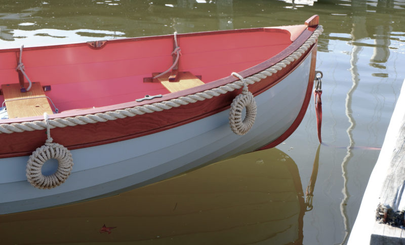 A set of doughnut fenders make a distinctive protection to the hull of the author's tender. Note the tails of the fenders on the port side tied to thwart knees.