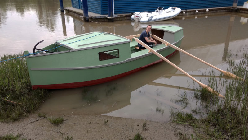 The boat was launched without ceremony or christening in the backwaters of the Fraser River. It floating high and had no leaks. The fisherman's anchor had its place in a recessed part of the foredeck.