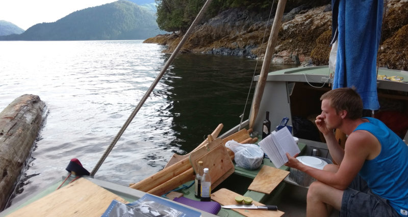 A driftwood log (at the left) crept by very slowly and paid us a visit behind Gilford Island near Thompson Sound. We were moored in a tiny shallow cove, with lines to shore off the bow and stern holding us just off a tiny beach.