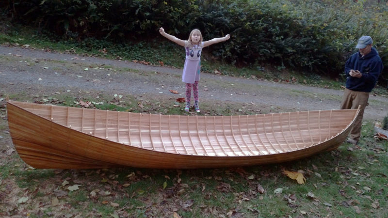 Planking complete, the hull was taken outside to be admired. Sigrid celebrated the occasion with a lollipop.
