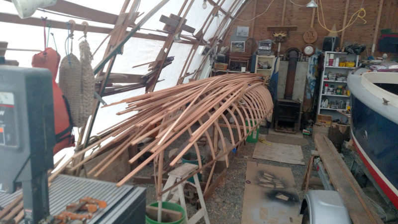 With all of the frames in place, planking with the red-cedar strips can begin.The guideboat project was squeezed in John's boat shed alongside his steam launch GALILEE.