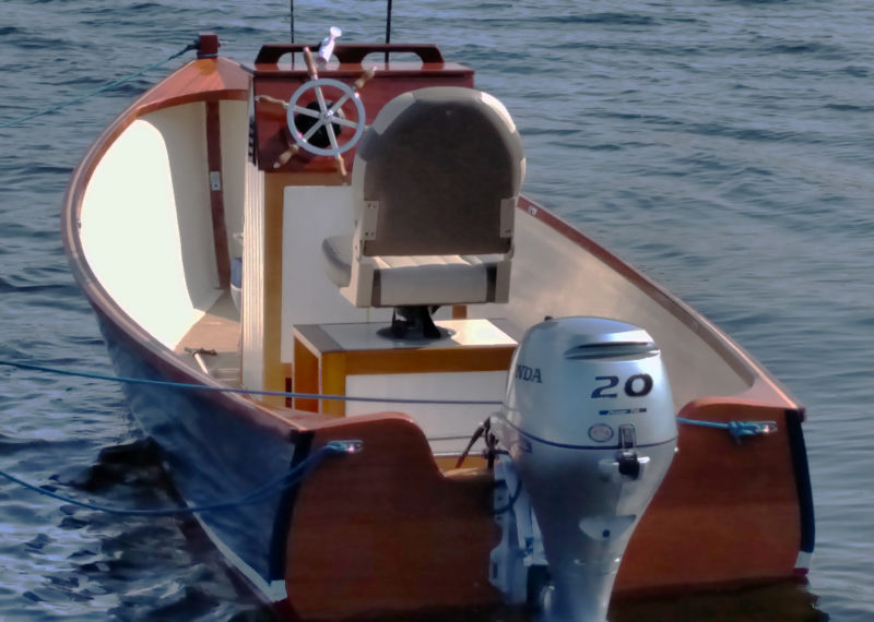 The 20-hp outboard will drive the skiff at speeds up to 24.5 mph.