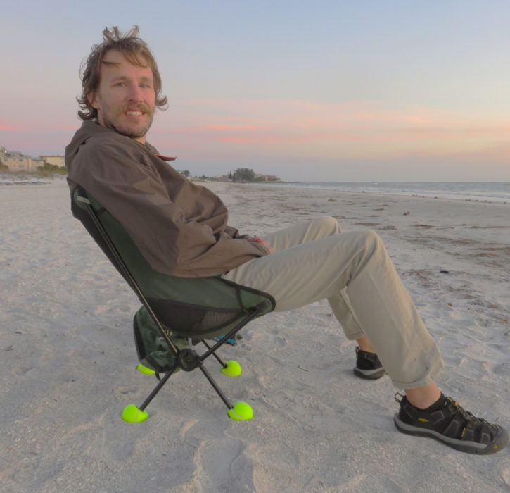 Four tennis balls slit to fit over the chair's feet keep them from sinking into sand.