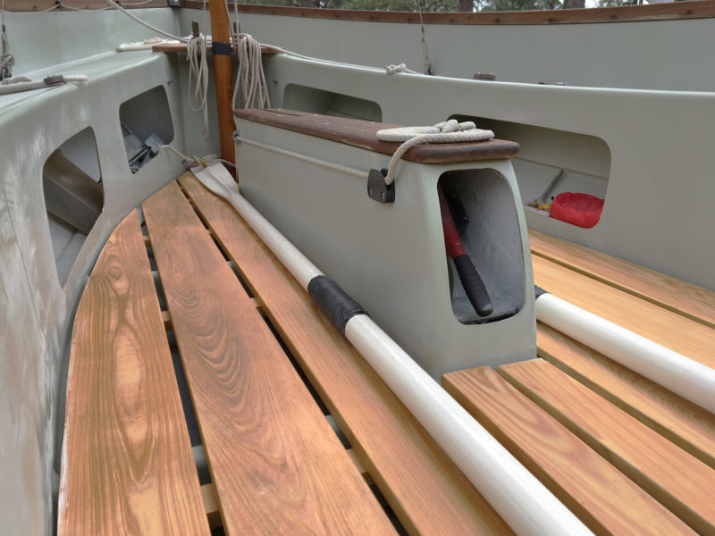 A compartment in the aft end of the centerboard trunk houses a bilge pump. The trunk houses a galvanized steel centerboard and is wide and strong enough to stand unsupported by thwarts.