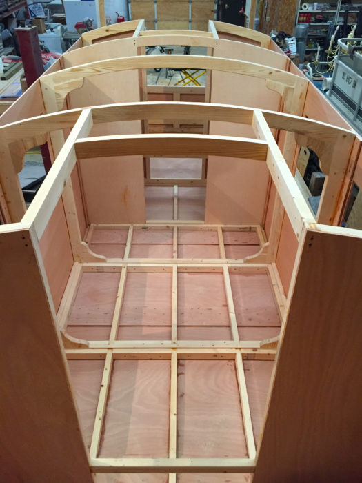 The view forward from the cockpit shows the extended main salon. The design normally calls for partial walls where the farther set of knees has been installed. Curt altered the framing to support an unobstructed floor.
