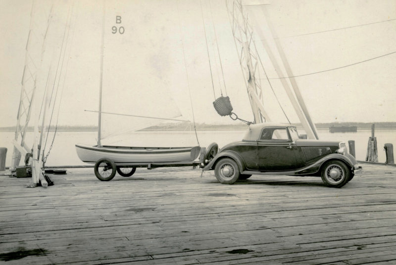 This Amphicraft isn't riding on the trailer designed for it. The car towing it appears to be a 1934 Ford Cabriolet Convertible Coupe,Roadster.