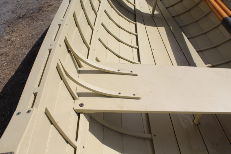 The steam-bent knees are light in weight and adequate for a boat that is meant for rowing and not subject to the racking forces of sailing.