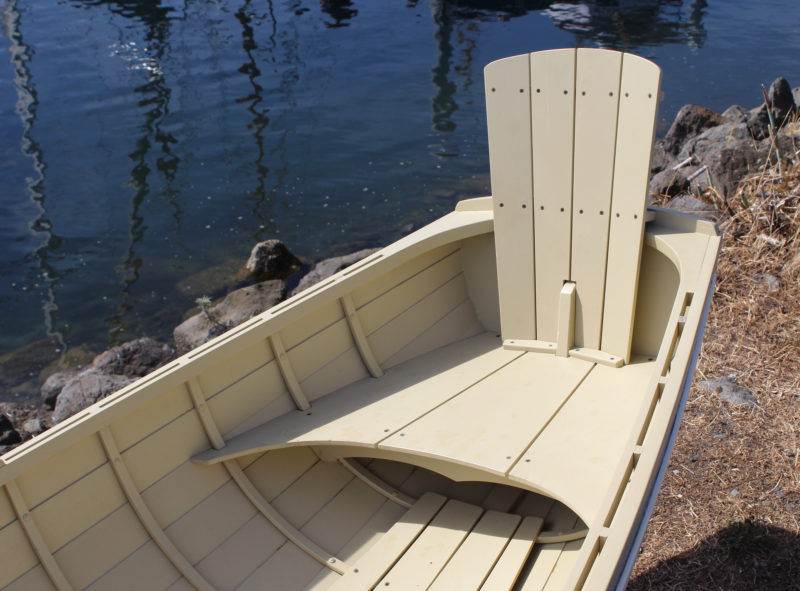 The tall back rest slips in place and has a cleat that bears on the inner face of the transom.