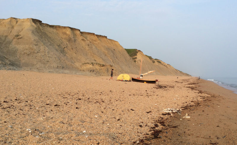At Hive Beach, near Burton Bradstock, Dorset, we used our inflatable boat rollers to push DUNLIN up the beach. We pitched the tent and cooked canned macaroni and cheese on our multi-fuel stove. There weren't many people on the beach, just us and a few fishermen.