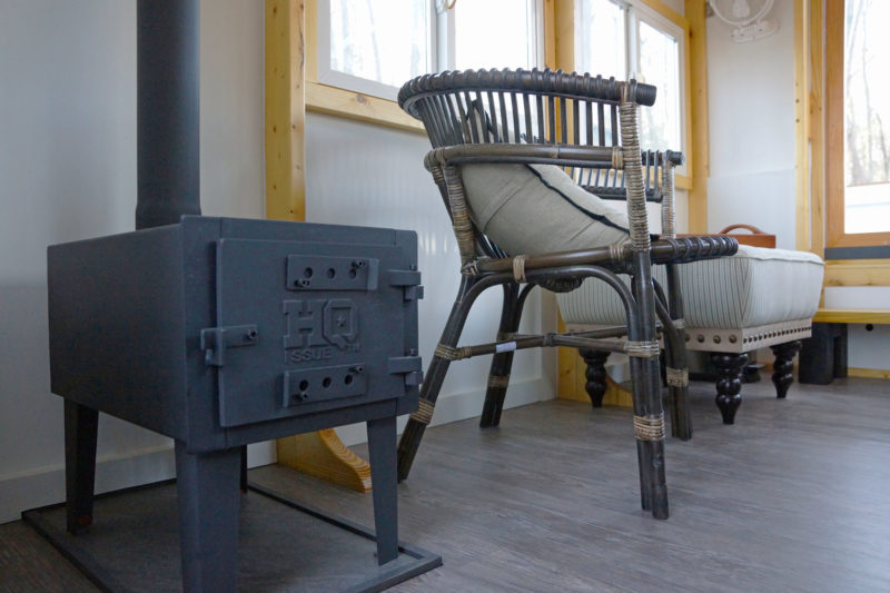 A stove designed for hot-tent camp,ing keeps the interior warm. The floor of an Escargot is normally obstructed by the framing that supports the hull; the addition of a smooth floor over the timbers makes for a cleaner look and a more comfortable space.