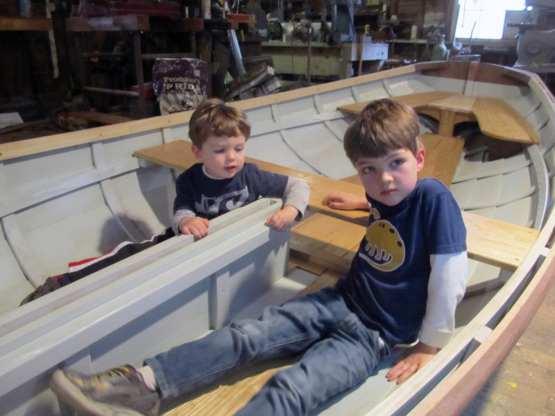 With the seats and centerboard case in, the boys are anxiously wondering when the boat will finally get in the water.