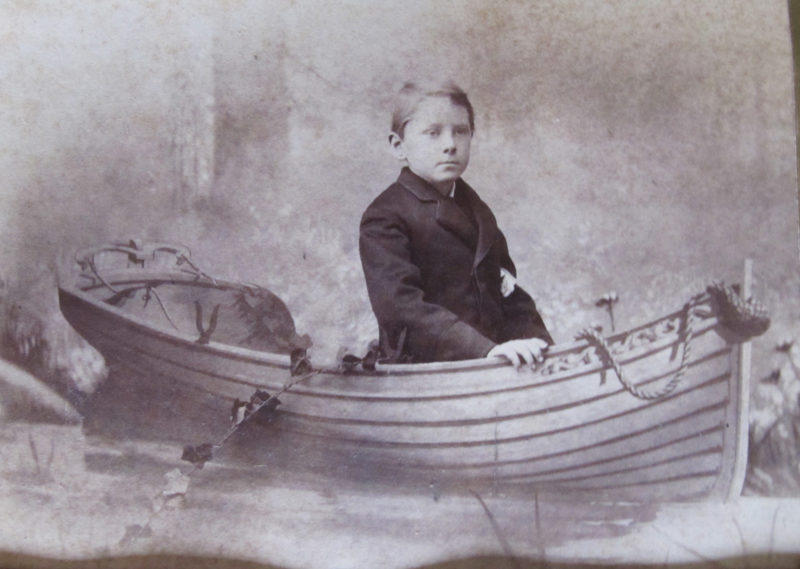 My great-great-grandfather, Benson Blake, seems to have been nudged his son Daniel Warren Blake toward an appreciation for boats when was very young. Although the boat young Daniel posed in for this photograph wasn't real, Benson's influence has extended through five generations.