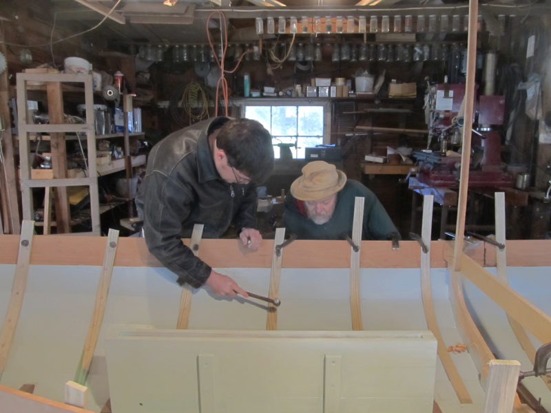 Dad and I worked side-by-side to rivet the steam bent-frames to the planks.