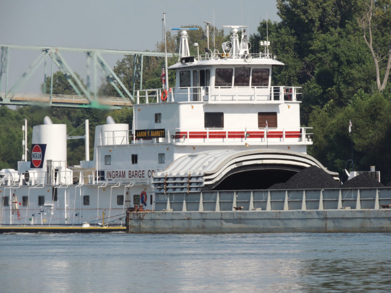 South of the Twin Cities, locks replace portages and a 9' deep channel assures safe passage for larger commercial and recreational vessels. Barges like this one became a common sight.