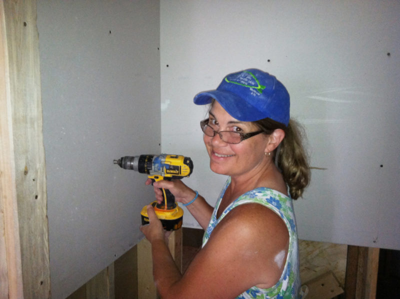 Barb put up drywall at a Habitat for Humanity build in Crystal, MN, after helping to insulate the house that would be a home for a family of nine