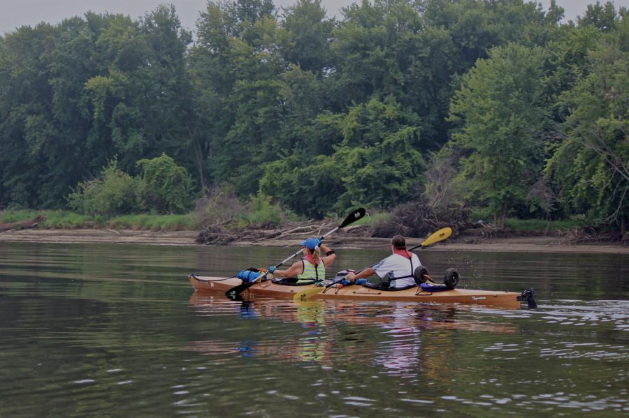 South of Dubuque, Iowa, a couple new friends accepted an invitation to paddle along for a day, and provided rare photos of both Barb and Gene in the kayak together.