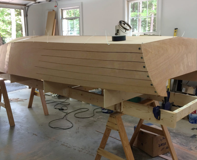 Kerfs in the aft half of the side panels make the compound curve at the stern possible.