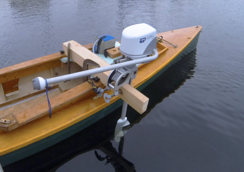 With a motor mount hastily sawn from a 4x4, I could test the motor on my lapstrake canoe. The speed was good; steering would have been better with a rudder or the motor located farther aft.