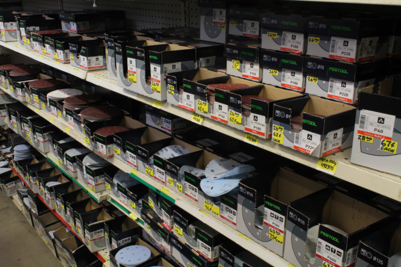 One side of one aisle has sanding discs that you can buy individually or by the box. There are a lot of products that you can buy without the plastic packaging that is common elsewhere.