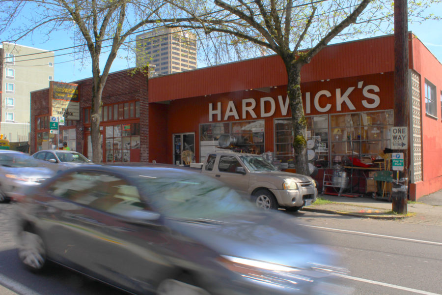Buildings like the one that looms behind the store will eventually eradicate neighborhood businesses that have been a part of Seattle's University District for many decades.