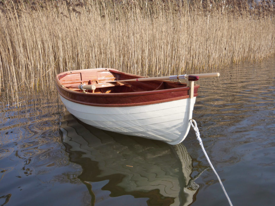 The dinghy sits lightly on the water and has enough volume to carry a complement of three.