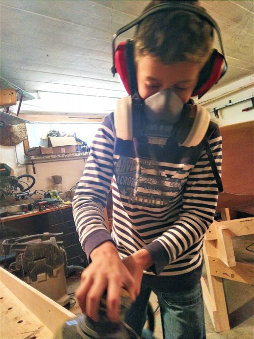 Sanding can be a tedious chore but Tristan suited up and did his fair share.