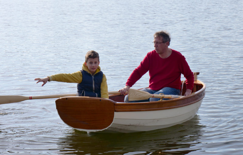 Father Ernst and son Tristan take the Auklet out for a spin under oars.