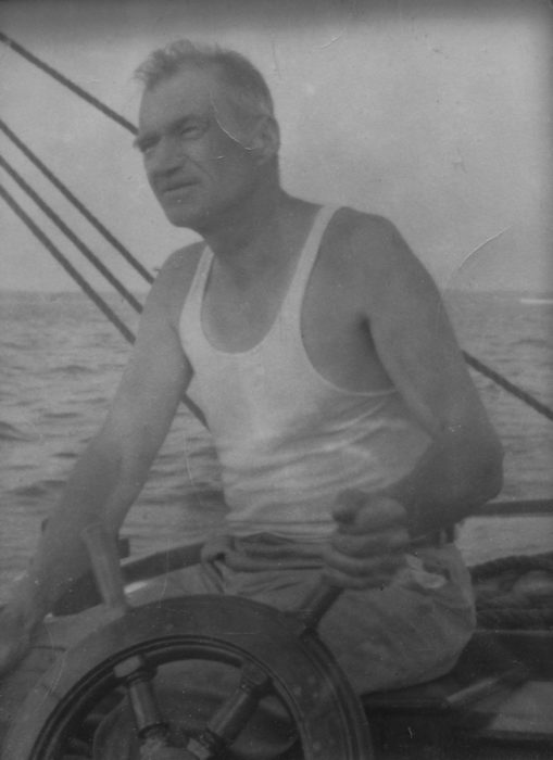 My grandfather, Francis Cunningham Sr., at the helm , sailing out of Marblehead