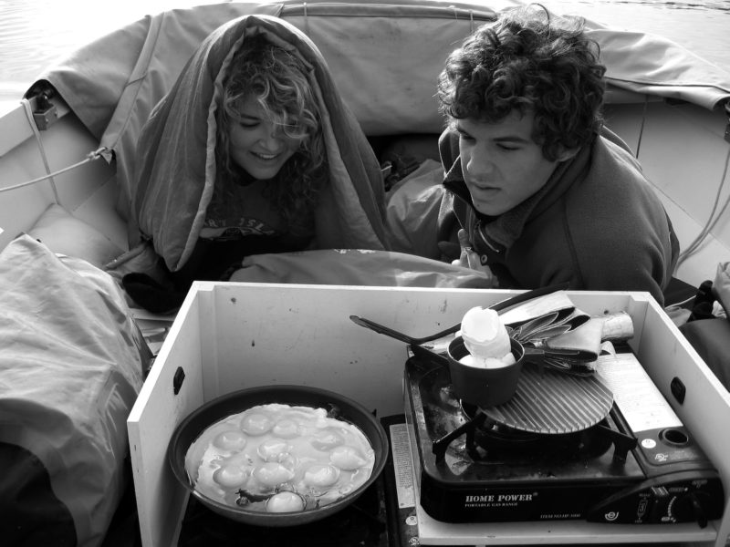 Ali and Nate enjoyed a Dad-cooked breakfast in bed and were happy to spend the better part of the day and night in their nest in the bow of the Caledonia yawl. The dodger that covers them at night is folded forward for the day.