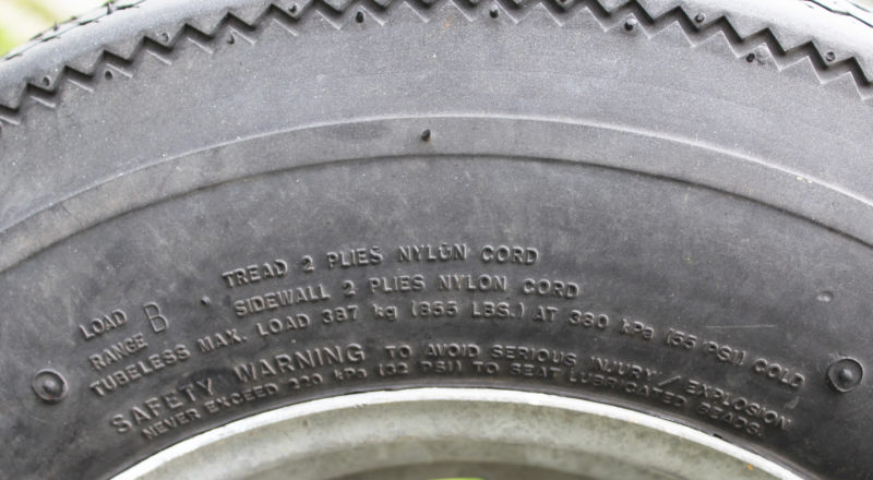 This Load Range B tire gives the actual number of thread and sidewall tires. The text also provides a maximum load (per tire) of 855 lbs and a maximum cold inflation pressure of 55 PSI. The maximum pressure should be used even if the load carried is less than the maximum indicated.