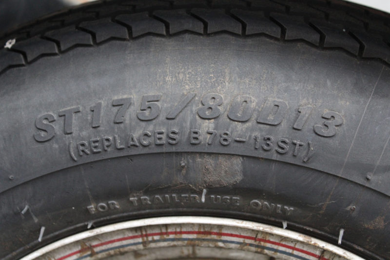 "This tire is marked ST for Special Trailer. It is 175 mm (6.9"") wide at its widest point and 80% as tall, 140mm (5.5"") from wheel rim to tread. It has diagonal fiber plies—D—and fits a 13"" rim."