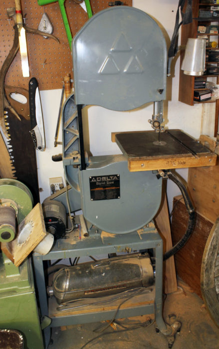 "I've been using this 14"" bandsaw for about 30 years. It's on casters to make it mobile . The vacuum doing the dust collection is an Electrolux that my mother bought around 1960. I remember the day the door-to-door Elextrolux salesman paid us a visit. To demonstrate the vacuum's power he attached a clear plastic tube to the hose nozzle and sock up three solid steel balls, one after the other, off the floor straight up into the tube."