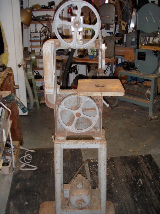 "My second 10"" Homecraft bandsaw, a curbside rescue, needed a bit of attention. Behind it is my first 10"", and to its right, my Delta 14""."