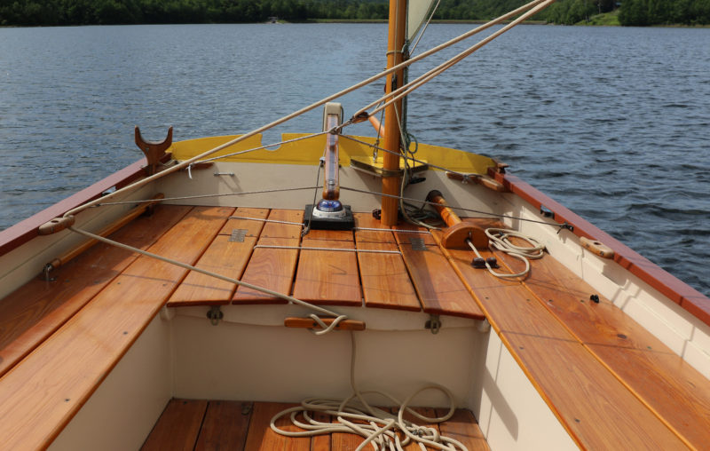The mizzen and boomkin are set to port to keep clear of the tiller. This boomkin is hollow, allowing the mizzen sheet to run through it. The arrangement helps the stern a little less busy and keeps the sheet from fouling on the tip of the boomkin when coming about.