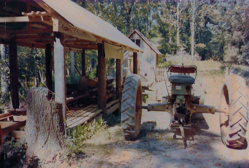 The old Model-A John Deere tractor was parked next to the circular-saw mill to power it. My dad and uncle must have been taking a break for lunch, otherwise and the sawmill would be running and one of them would be riding on the carriage.