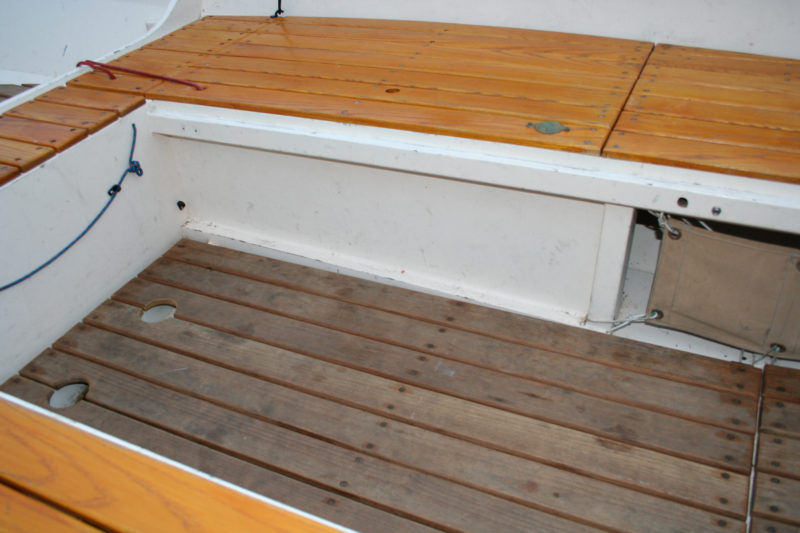 The off-center-board in my Caledonia yawl supports the starboard bench. It's so inconspicuous that I often forget to lower the board when I set sail.