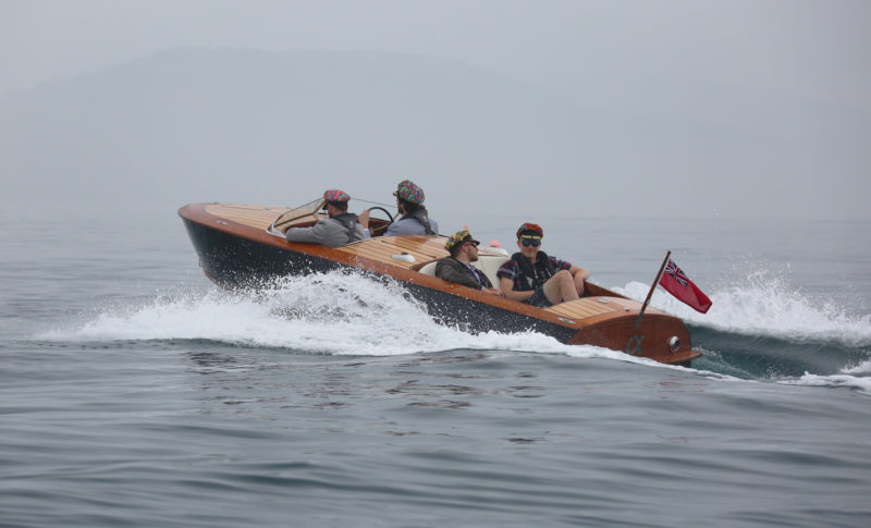 The seats in the aft cockpit face the stern, appropriate for the design's original purpose of towing water skiers.