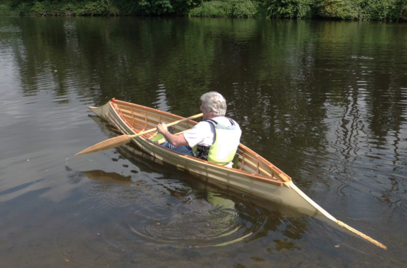 Paul's first opportunity to paddle the canoe he built was on the day he delivered it to Harry. OLd photographs of the traditionally built, bark-skinned canoes show native paddlers kneeling as well as sitting.