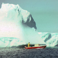 When you catch a big fish, you take a photo. When you pass a grounded iceberg, you do the same. The notorious Iceberg Alley passes down the Labrador coast just a few miles offshore; 'bergs often drift from the current and go aground on Labrador shallows. Geof and TORNGAT check one out.
