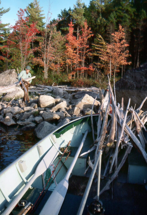 As a family fun boat, TORNGAT is often pressed into service for camping and fishing on Maine's big northern lakes. Driftwood abounds along these shores, and a regular chore of setting up camp is gathering a good supply of firewood.