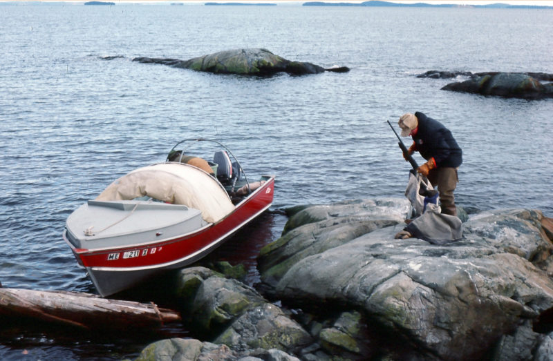 After Labrador, TORNGAT went into local use, and here she's unloading a sea-duck hunter on a Maine coast ledge. The big skiff was always welcome transport in late autumn's blustery days.