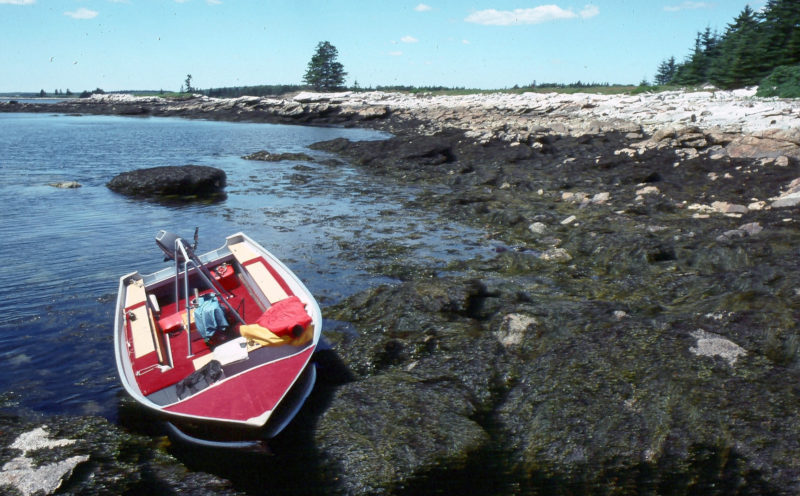 Not a wreck but just resting, an SSV-18 of the Maine Island Trail Association is grounded out while her crew works on an island campsite. The tough aluminum boats are ideal for this sort of work. MITA has had a fleet of four of them for 10 years and expects at least another decade of service each of these boats.