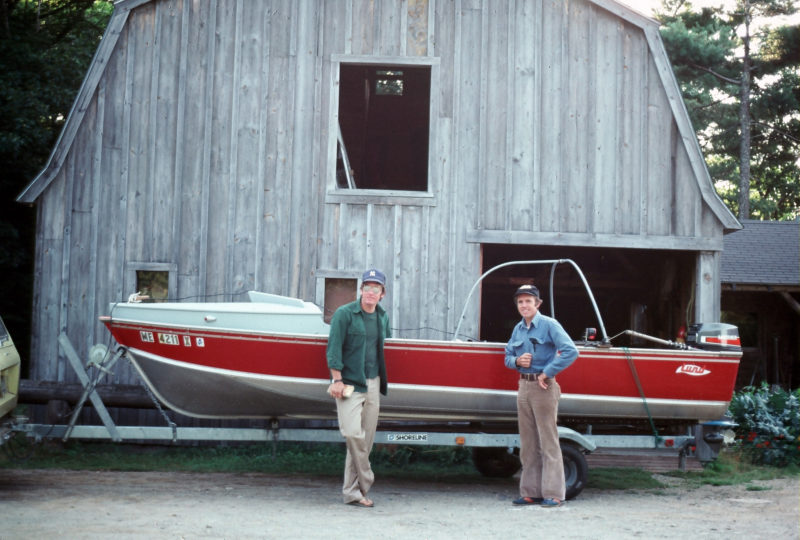 All ready for the North Country, the three companions—Geof Heath, left, the author, right, and TORNGAT—pose for a family shot. With all of our modifications, our boat has lost its skiff appearance.