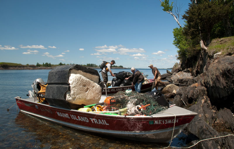 Two MITA SSV-18s pick up a load of washed-up island trash for disposal ashore. The four large-capacity open boats do yeoman service along the length of the Maine coast on both state-owned and private islands in the trail.