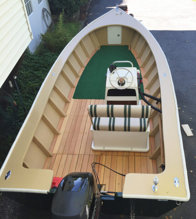 The plans leave the interior design to the builder. The off-center console offers easy passage from bow to stern; the carpeted area forward has enough room for four folding chairs.
