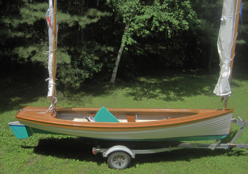 Patrick MacQueen's slotted foredeck and modification of the Herreshoff arrangement for the decks maintained the the boat's original functions and gave it a different, but fitting appearance.