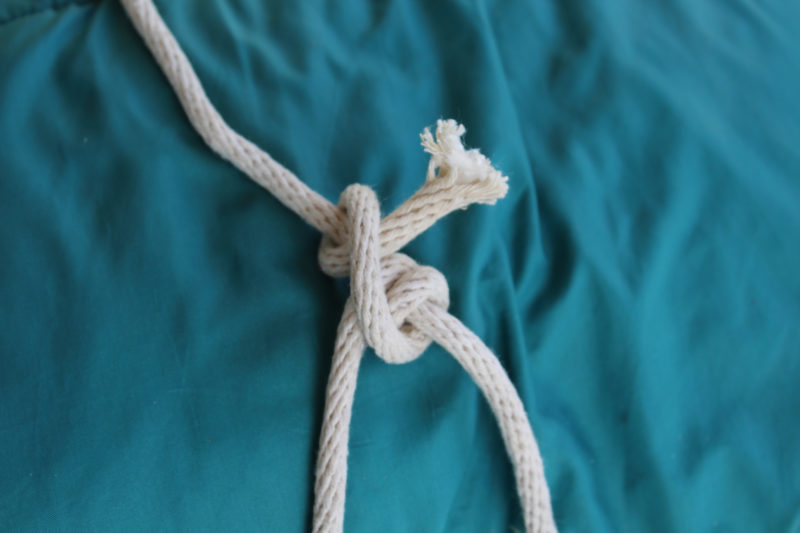 The working end then crosses over itself for another wrap, tucked under itself. The rolling hitch is like the more common clove hitch with an extra wrap.