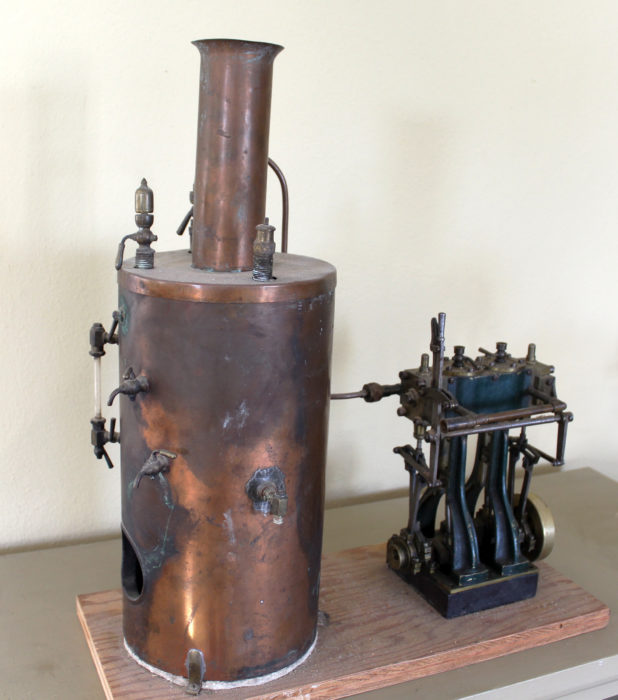 The model is powered by a copper boiler secured to the plywood base over a fire-proof jewelers soldering board.